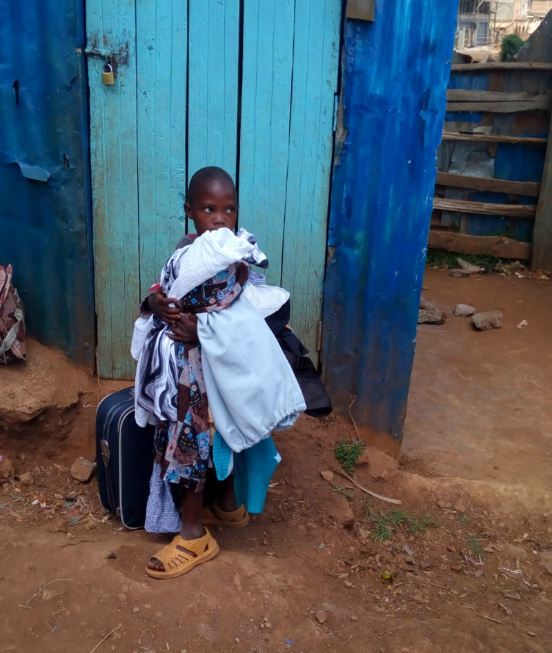 A little girl with a bundle of clothes!
